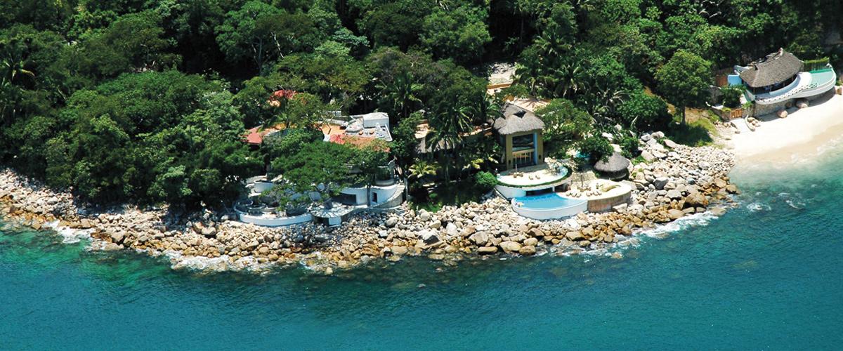 Puerto Vallarta real estate in exclusive oceanfront terrain.